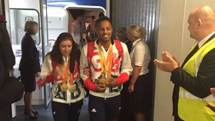 The Paralympians sported their medals as they began the walk through the airport arrivals.