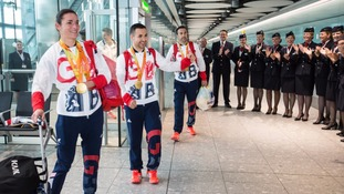 Sarah Storey and Will Bayley led the medal winners off the flight as they received applause from BA staff.