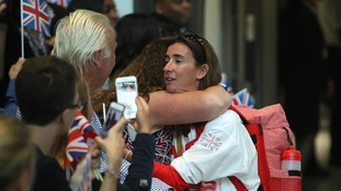 Melissa Reid earned a big hug after arriving at Heathrow Airport.
