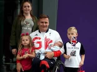 David Weir was welcomed by his family, including his newborn son Lenny.