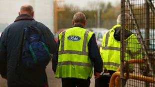 Workers leave the Ford Transit Assembly Plant in Southampton after being told that the site will close.