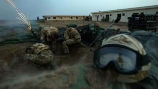 A mortar team from 40 Commando fires phosphorus mortar
