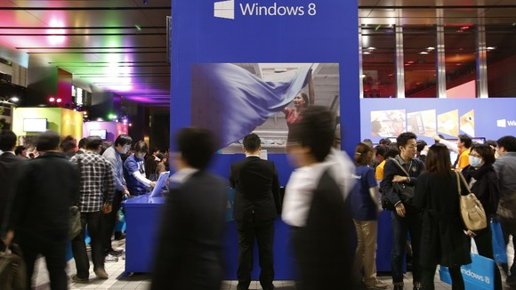People attend an event promoting the debut of Microsoft&#x27;s Windows 8