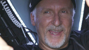 filmmaker James Cameron gives two thumbs-up as he emerges from the Deepsea Challenger
