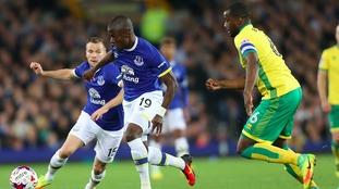 Sébastien Bassong challenges Everton's Enner Valencia.
