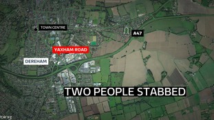 Police in Norfolk are hunting a man who stabbed two people in an alleyway in Dereham.
