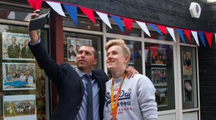 Paralympic swimmer receives a hero's welcome at school