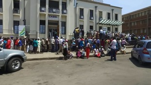 Queues at banks in Zimbabwe where money is running out