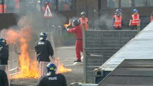 A rioter throws a petrol bomb at police during the demonstration.