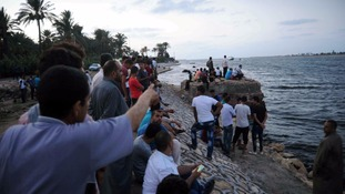 Relatives of those missing in the disaster gather at the sea shore.