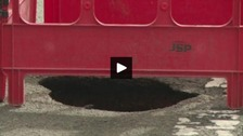 Eight-foot sinkhole opens up on residential street
