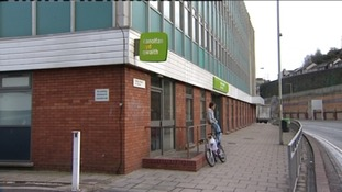 Young person sat outside a Jobcentre