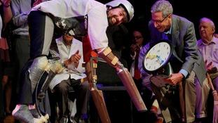 Thomas Thwaites accepts his Ig Nobel prize for biology.