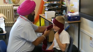 Children get a lesson on turban tying