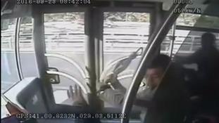 Bus crashes on highway after passenger attacks driver with umbrella