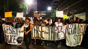 Charlotte protesters defy curfew to demand police release video of deadly shooting