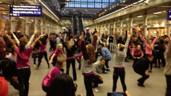 Team London Ambassadors dance at St Pancras station.