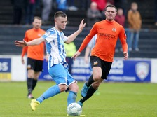 Coleraine's Adam Mullean gets a pass off against Glenavon.