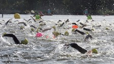 Thousands dive in to swim a mile at London's Hyde Park lake