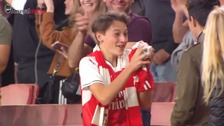 Mesut Ozil makes young fan's day by throwing his shirt.