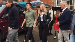 Joe Pugh and Leah Washington (holding hands) and Vicky Balch (in red dress).
