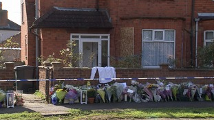 Flowers outside the house of murder victim David Brickwood