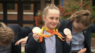 Ellie Robinson shows off the gold and bronze medals she won in Rio