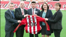 Gary Hutchinson, Commercial Director, Sunderland AFC with staff from Sunderland College