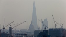 Smog surrounds the Shard in central London.