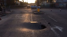 Sinkhole opens up on street in east London