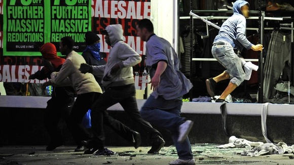 Looters run from a clothing store in Peckham, London August 8, 2011.