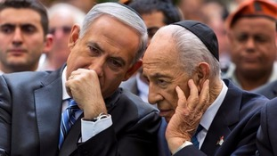 Benjamin Netanyahu chats with Shimon Peres in 2013.