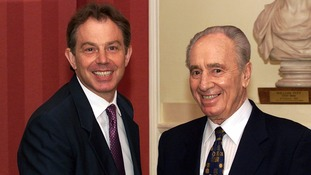 Tony Blair greeted then Israeli Foreign Affairs Minister Shimon Peres in 2003.
