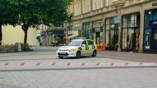Arrest after two bodies found in busy Cardiff street