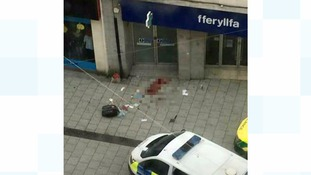 A 20-year-old man from Gwent has been arrested after a man and woman found dead on Cardiff Street