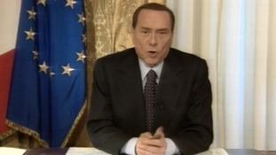 Silvio Berlusconi announcing his decision not to run in the next general election