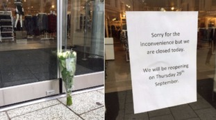 Flowers left outside the Matalan store in Cardiff.