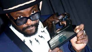 Will.i.am collects an award earlier this year.