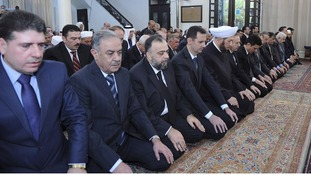 Syria's President Bashar al-Assad performs prayers at al-Afram Mosque in Damascus