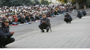 Police take part in prayers on the first day of the Muslim holiday of Kurban Bairam in Bishkek