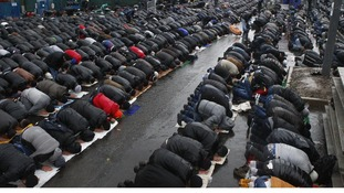 Muslims take part in prayers on the first day of the Muslim holiday of Kurban Bairam in Moscow
