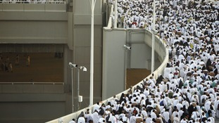 Muslim pilgrims arrive to cast stones at pillars symbolising Satan on the first day of Eid al-Adha in Mena
