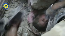 Moment five-year-old girl is pulled out rubble in Syria