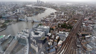 A view across London of Tower Bridge and Canary Wharf in the east from the Shard