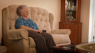 Elderly woman on sofa