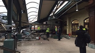 Witnesses take photos of the damage at the station.