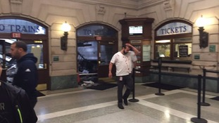 A shocked man covered in blood pictured at the train station in Hoboken.