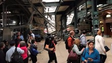 At least one dead as train crashes into New Jersey station