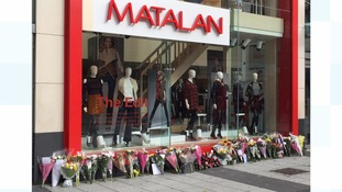Tributes left outside the Matalan store where both Miss Morgan and Mr Simmons worked.