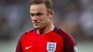 Rooney to keep England armband